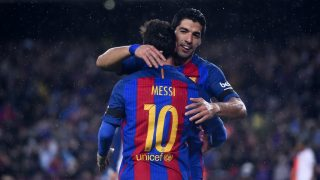 Barcelona's Argentinian forward Lionel Messi (L) is congratulated by his teammate Barcelona's Uruguayan forward Luis Suarez after scoring during the Spanish league football match FC Barcelona vs Sevilla FC at the Camp Nou stadium in Barcelona on April 5, 2017. / AFP PHOTO / Josep LAGO