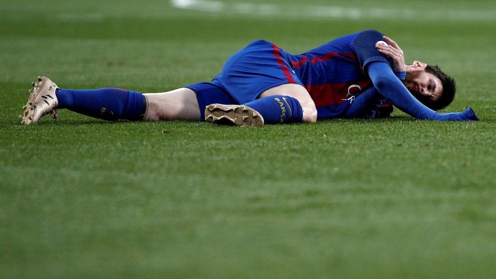 MADRID, SPAIN - APRIL 23: Lionel Messi of Barcelona is injured during the La Liga match between Real Madrid and Barcelona at Santiago Bernabeu Stadium in Madrid, Spain on April 23, 2017. Burak Akbulut / Anadolu Agency