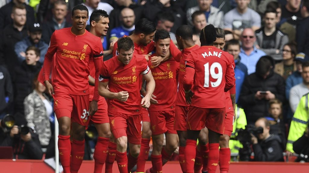 Liverpool's Brazilian midfielder Philippe Coutinho (C) celebrates with teammates after scoring their second goal during the English Premier League football match between Liverpool and Everton at Anfield in Liverpool, north west England on April 1, 2017. / AFP PHOTO / Paul ELLIS / RESTRICTED TO EDITORIAL USE. No use with unauthorized audio, video, data, fixture lists, club/league logos or 'live' services. Online in-match use limited to 75 images, no video emulation. No use in betting, games or single club/league/player publications.  /