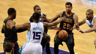 CHARLOTTE, USA - MARCH 20: Kemba Walker (15) of Charlotte Hornets in action against Thabo Sefolosha (25) of Atlanta Hawks during the NBA match between Charlotte Hornets vs Atlanta Hawks? at the Spectrum arena in Charlotte, United States on March 20, 2017. Peter Zay / Anadolu Agency