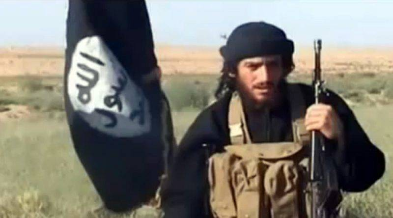 """An image grab taken from a video uploaded on YouTube on July 8, 2012, shows the spokesman for the Islamic State of Iraq and the Levant (ISIL), Abu Mohammad al-Adnani al-Shami, speaking next to an Al-Qaeda-affiliated flag at an undisclosed location. AFP PHOTO / YOUTUBE == RESTRICTED TO EDITORIAL USE - MANDATORY CREDIT """"AFP PHOTO / YOUTUBE """" - NO MARKETING NO ADVERTISING CAMPAIGNS - DISTRIBUTED AS A SERVICE TO CLIENTS FROM FROM ALTERNATIVE SOURCES, THEREFORE AFP IS NOT RESPONSIBLE FOR ANY DIGITAL ALTERATIONS TO THE PICTURE'S EDITORIAL CONTENT, DATE AND LOCATION WHICH CANNOT BE INDEPENDENTLY VERIFIED / AFP PHOTO / YouTube / -"""