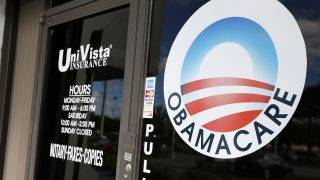 (FILES) This file photo taken on January 10, 2017 shows an Obamacare logo on the door of the UniVista Insurance agency in Miami, Florida. US lawmakers hold their most contentious vote of Donald Trump's young presidency on May 4, 2017 on a revived Republican bid to repeal Barack Obama's signature health reforms. After weeks of in-party feuding, and mounting pressure from the White House for Congress to deliver Trump a big legislative victory, Republican leaders say they now have the votes to pass the controversial measure.ity. / AFP PHOTO / RHONA WISE