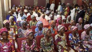 (FILES) This file photo taken on October 19, 2016 shows 21 Chibok girls who were released by Boko Haram a week before, attending a meeting with the Nigerian President at the State House in Abuja, Nigeria.  At least 80 schoolgirls who were among more than 200 kidnapped by Boko Haram in northeast Nigeria in 2014 have been released, security sources, a senior minister and the father of two of them told AFP on May 6, 2017. / AFP PHOTO / Philip OJISUA