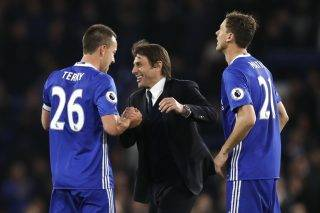 Chelsea's Italian head coach Antonio Conte (C) celebrates with Chelsea's English defender John Terry and Chelsea's Serbian midfielder Nemanja Matic after winning the English Premier League football match between Chelsea and Middlesbrough at Stamford Bridge in London on May 8, 2017. / AFP PHOTO / Adrian DENNIS / RESTRICTED TO EDITORIAL USE. No use with unauthorized audio, video, data, fixture lists, club/league logos or 'live' services. Online in-match use limited to 75 images, no video emulation. No use in betting, games or single club/league/player publications.  /