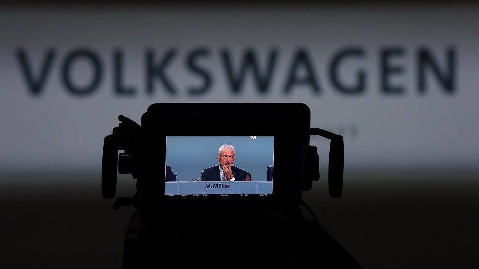(FILES) This file photo taken on May 10, 2017 shows Matthias Mueller, CEO of German carmaker Volkswagen (VW), pictured on a camera screen during the German carmaker Volkswagen shareholders' annual general meeting in Hanover, northern Germany. German prosecutors said on May, 17, 2017 they had opened a new investigation into Volkswagen chief executive Matthias Mueller and others over market manipulation in the wake of the carmaker's 'dieselgate' scandal. / AFP PHOTO / RONNY HARTMANN