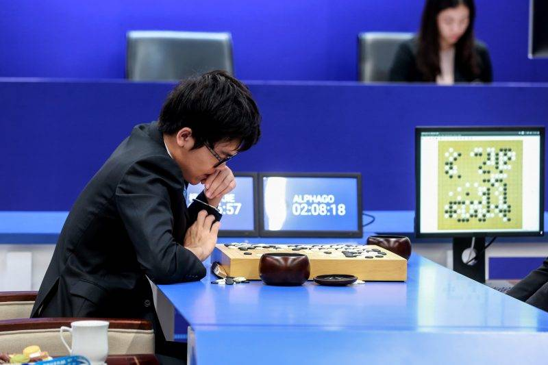 China's 19-year-old Go player Ke Jie prepares to make a move during the second match against Google's artificial intelligence programme AlphaGo in Wuzhen, eastern China's Zhejiang province on May 25, 2017.  Chinese netizens fumed on May 25 over a government ban on live coverage of Google algorithm AlphaGo's battle with the world's top Go player, as the programme clinched their three-match series in the ancient board game. / AFP PHOTO / STR / China OUT