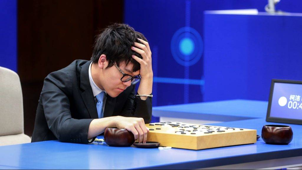 China's 19-year-old Go player Ke Jie reacts during the second match against Google's artificial intelligence programme AlphaGo in Wuzhen, eastern China's Zhejiang province on May 25, 2017.  Chinese netizens fumed on May 25 over a government ban on live coverage of Google algorithm AlphaGo's battle with the world's top Go player, as the programme clinched their three-match series in the ancient board game. / AFP PHOTO / STR / China OUT