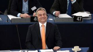 Hungary's Prime minister Viktor Orban (C) smiles during a debate on the Hungary's situation at the European Parliament in Strasbourg, eastern France on May 19, 2015. AFP PHOTO / FREDERICK FLORIN / AFP PHOTO / FREDERICK FLORIN