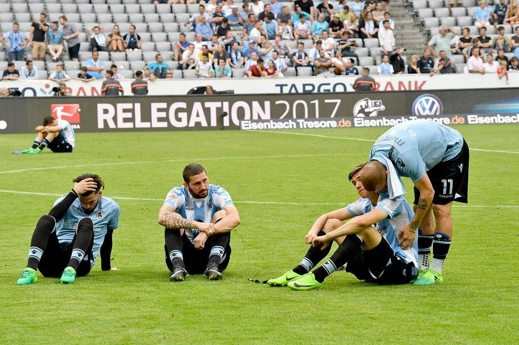 Munich players sit on the pitch after the German Bundesliga 2nd division relegation soccer match between TSV1860 Munich and Jahn Regensburg in the Allianz Arena in Munich,Germany, 30 May 2017. 1860 Munich descended to the 3rd divison after this game. Photo: Peter Kneffel/dpa