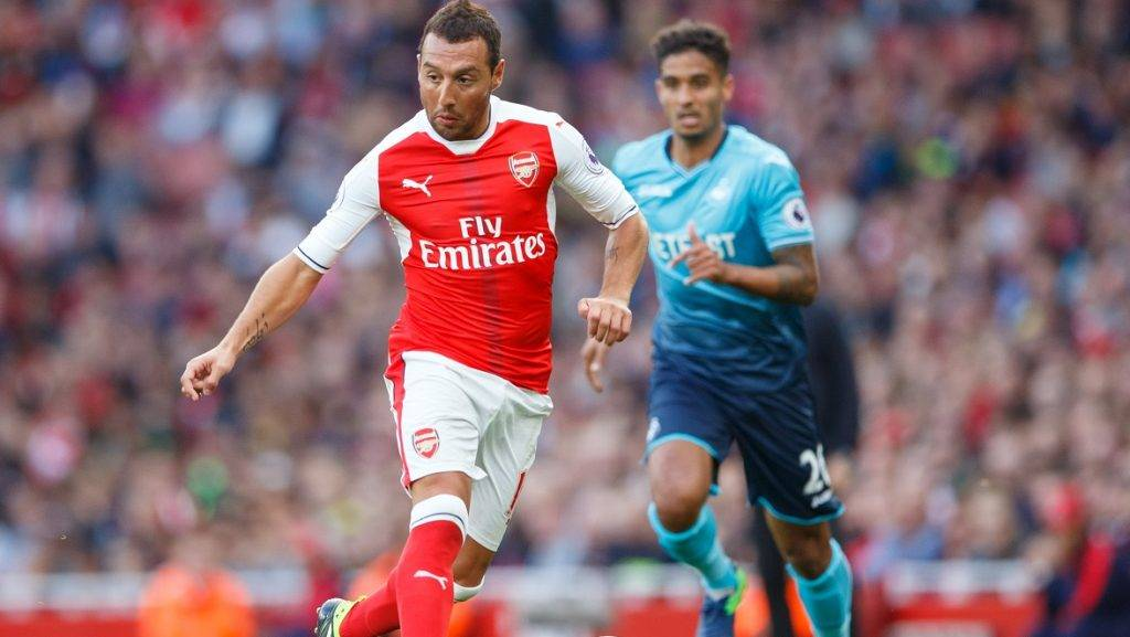 Santi Cazorla of Arsenal and Kyle Naughton of Swansea City during the Premier League match between Arsenal and Swansea City played at The Emirates Stadium, London, England, October 15, 2016 - Photo Ben Queenborough / Backpage Images / DPPI