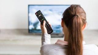 Woman watching TV.  Paris, France   VOISIN/PHANIE