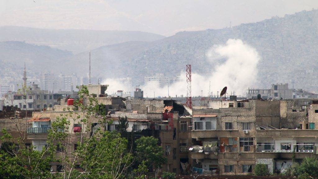 DAMASCUS, SYRIA - MAY 04: Smoke rises after Assad regime forces attacked opposition controlled Qaboun district of Damascus, Syria on May 04, 2017. Regime forces hit residential areas with ground and air strikes.  Samir Tatin / Anadolu Agency