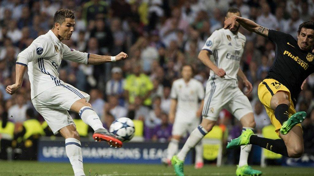 Real Madrid's Portuguese forward Cristiano Ronaldo kicks to score his second goal during the UEFA Champions League semifinal first leg football match Real Madrid CF vs Club Atletico de Madrid at the Santiago Bernabeu stadium in Madrid, on May 2, 2017. / AFP PHOTO / CURTO DE LA TORRE