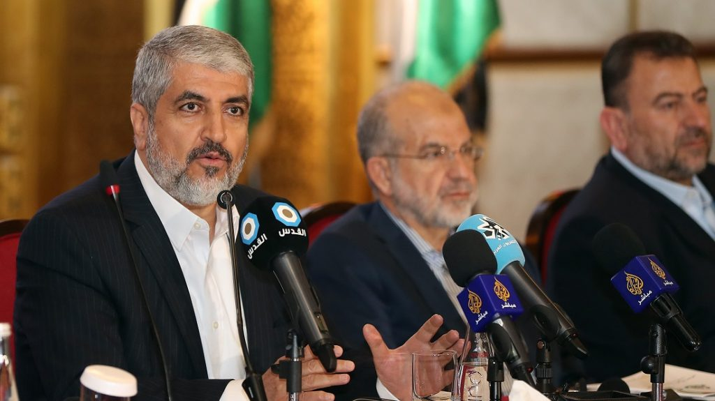 Exiled Chief of Hamas' Political Bureau Khaled Meshaal (L) speaks during conference in the Qatari capital, Doha on May 1, 2017. The Palestinian Islamist movement Hamas unveiled a new policy document easing its stance on Israel after having long called for its destruction, as it seeks to improve its international standing. / AFP PHOTO / KARIM JAAFAR
