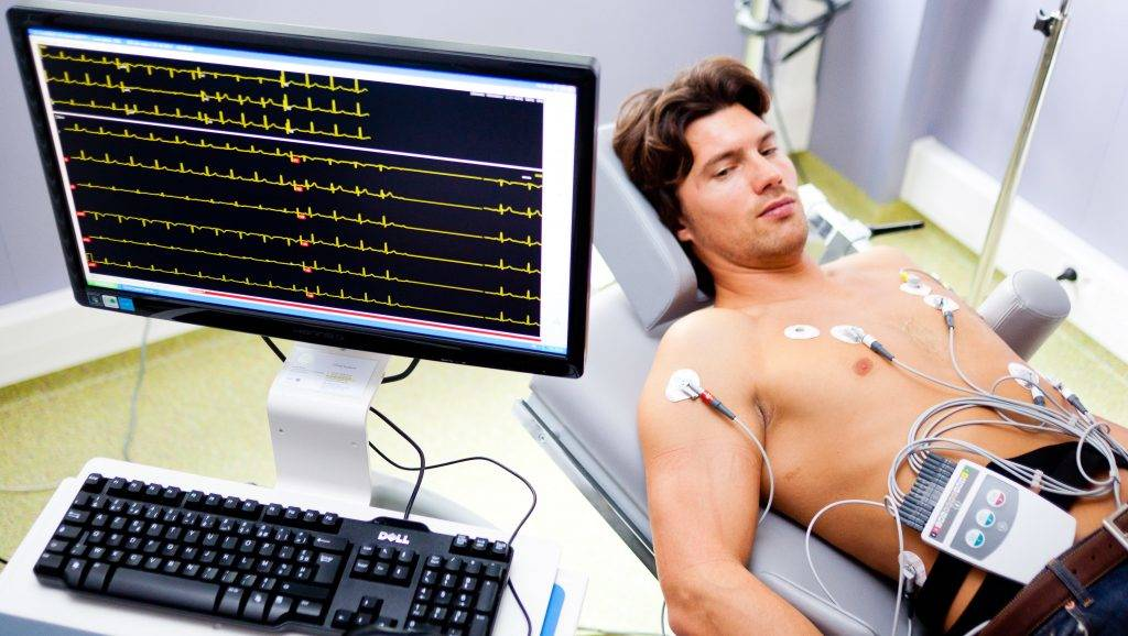 Portable heart monitor, Man wearing a portable electrocardiograph hanging on a strap from his neck, Limoges hospital, France.  CHU de Limoges   BURGER/PHANIE