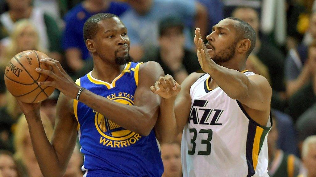 SALT LAKE CITY, UT - MAY 6: Boris Diaw #33 of the Utah Jazz defends against Kevin Durant #35 of the Golden State Warriors in the first half in Game Three of the Western Conference Semifinals during the 2017 NBA Playoffs at Vivint Smart Home Arena on May 6, 2017 in Salt Lake City, Utah. NOTE TO USER: User expressly acknowledges and agrees that, by downloading and or using this photograph, User is consenting to the terms and conditions of the Getty Images License Agreement.   Gene Sweeney Jr/Getty Images/AFP