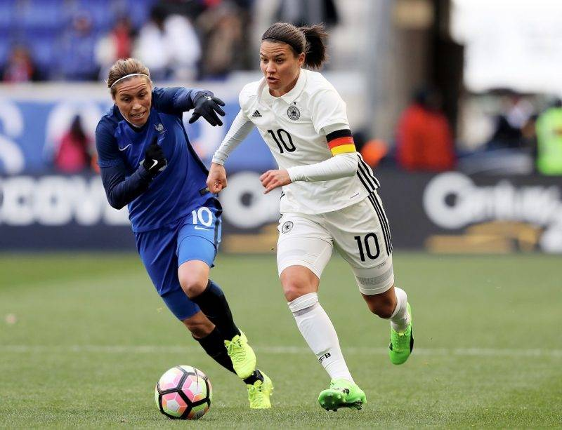 HARRISON, NJ - MARCH 04: Dzsenifer Marozsan #10 of Germany and Camille Abily #10 of France fight for the ball in the first half during the SheBelieves Cup at Red Bull Arena on March 4, 2017 in Harrison, New Jersey.   Elsa/Getty Images/AFP
