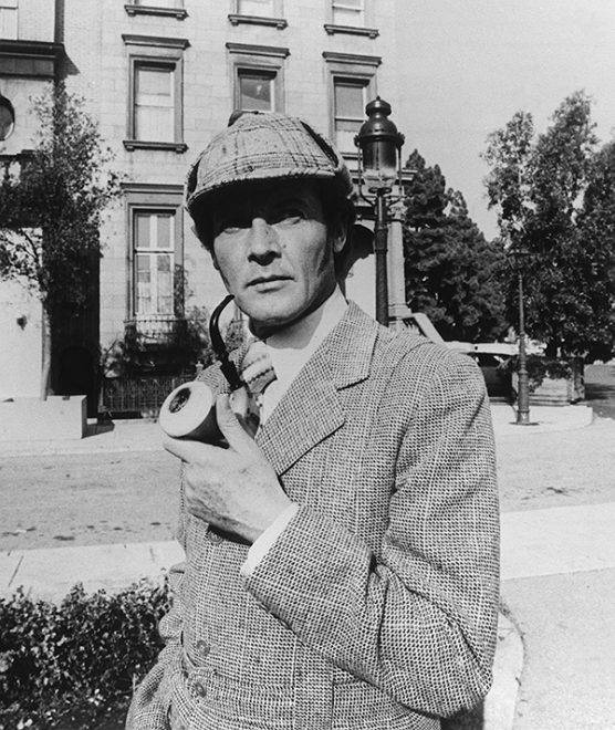"""Roger Moore with pipe in """"Sherlock Holmes in New York"""" in 1976."""