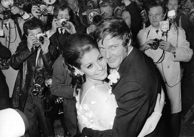 11th April 1969:  Italian actress Luisa Mattioli and English actor Roger Moore  outside Caxton Hall, London, after their wedding ceremony.  (Photo by Bob Aylott/Keystone/Getty Images)