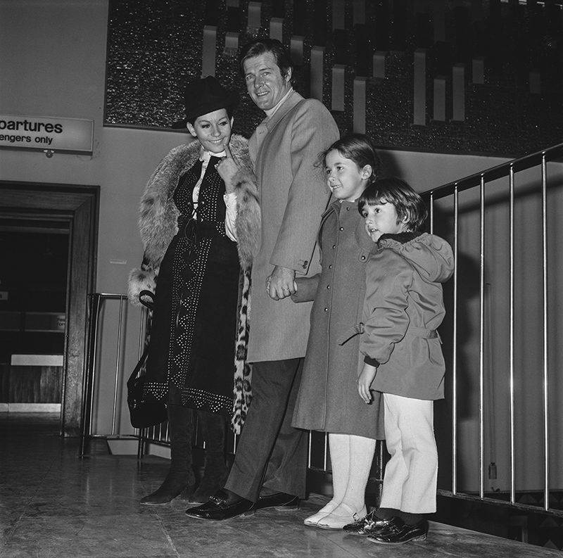 English actor Roger Moore with his wife Luisa Mattioli and their children at London Airport, UK, 16th January 1971. Their daughter Deborah (pictured) later became an actress. (Photo by Dove/Daily Express/Getty Images)
