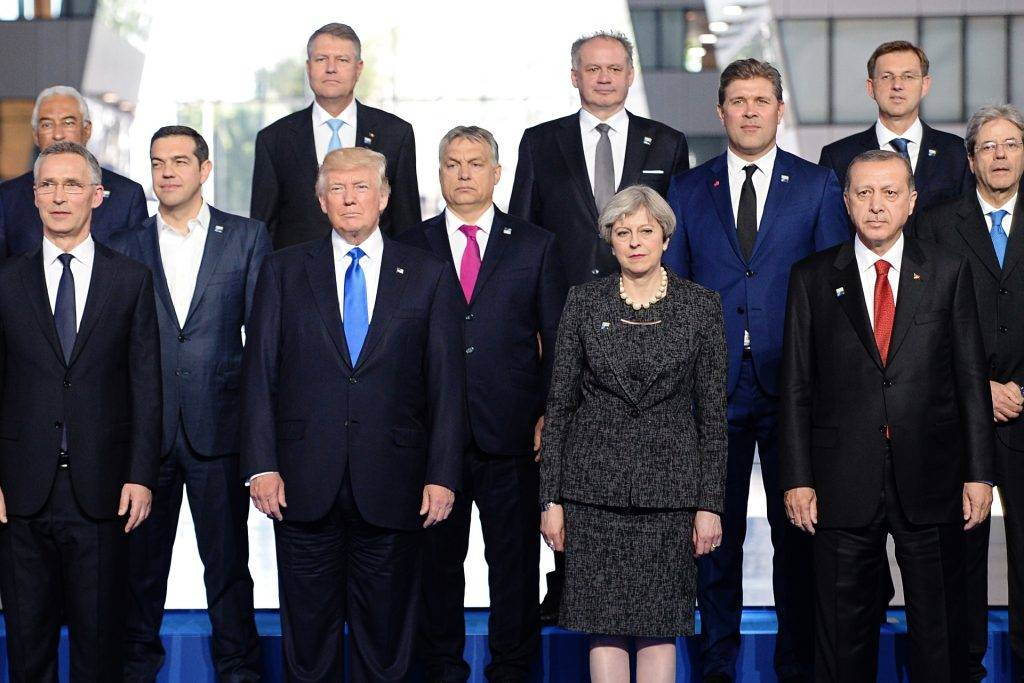 (Front row from L) NATO Secretary General Jens Stoltenberg, US President Donald Trump, Britain's Prime Minister Theresa May, Turkish President Recep Tayyip Erdogan, (second row from L) Greek Prime Minister Alexis Tsipras, Hungary's Prime Minister Viktor Orban, Iceland's Prime Minister Bjarni Benediktsson, Italian Prime Minister Paolo Gentiloni, (third row from L) Portuguese Prime Minister Antonio Costa, Romanian President Klaus Werner Iohannis, Slovakia's President Andrej Kiska, Slovenian Prime Minister Miro Cerar pose for a family picture during the NATO (North Atlantic Treaty Organization) summit at the NATO headquarters, in Brussels, on May 25, 2017.  / AFP PHOTO / POOL / Stefan Rousseau