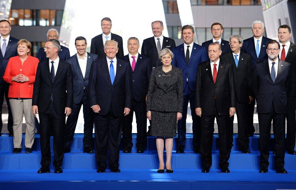 (Front row from L)  NATO Secretary General Jens Stoltenberg, US President Donald Trump, Britain's Prime Minister Theresa May, Turkish President Recep Tayyip Erdogan, Spanish Prime Minister Mariano Rajoy, (second row from L) German Chancellor Angela Merkel, Greek Prime Minister Alexis Tsipras, Hungary's Prime Minister Viktor Orban, Iceland's Prime Minister Bjarni Benediktsson, Italian Prime Minister Paolo Gentiloni, Latvia's President Raimonds Vejonis, (third row from L)  Polish President Andrzej Duda, Portuguese Prime Minister Antonio Costa, Romanian President Klaus Werner Iohannis, Slovakia's President Andrej Kiska, Slovenian Prime Minister Miro Cerar and Montenegro's Prime Minister Dusko Markovic  pose for a family picture during the NATO (North Atlantic Treaty Organization) summit at the NATO headquarters, in Brussels, on May 25, 2017.  / AFP PHOTO / POOL / Stefan Rousseau