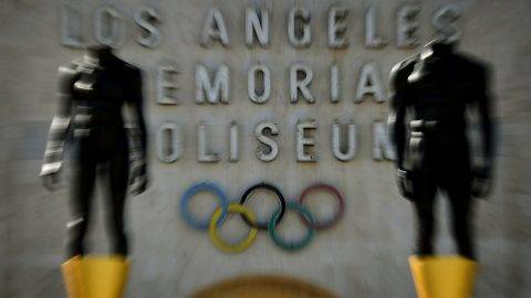 An Olympic themed monument stands beside the Los Angeles Memorial Coliseum after rival Budapest dropped its bid for the 2024 Olympics, in Los Angeles, California on February 22, 2017. Budapest has became the latest city to drop out of the race to host the 2024 Olympic Games, after a petition garnered enough signatures to force a referendum on their bid.  / AFP PHOTO / Mark RALSTON