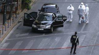 ATHENS, GREECE - MAY 25: Crime scene investigators inspects a Mercedes S-series of former Greek Prime Minister Lucas Papademos after an explosion caused by a bombing attack in Athens, Greece on May 25, 2017. Ayhan Mehmet / Anadolu Agency