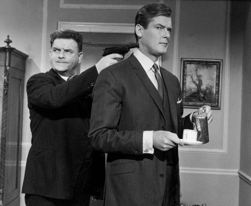 """Rooger Moore (r) and Godrey Quigley (l) in """"The Saint""""."""