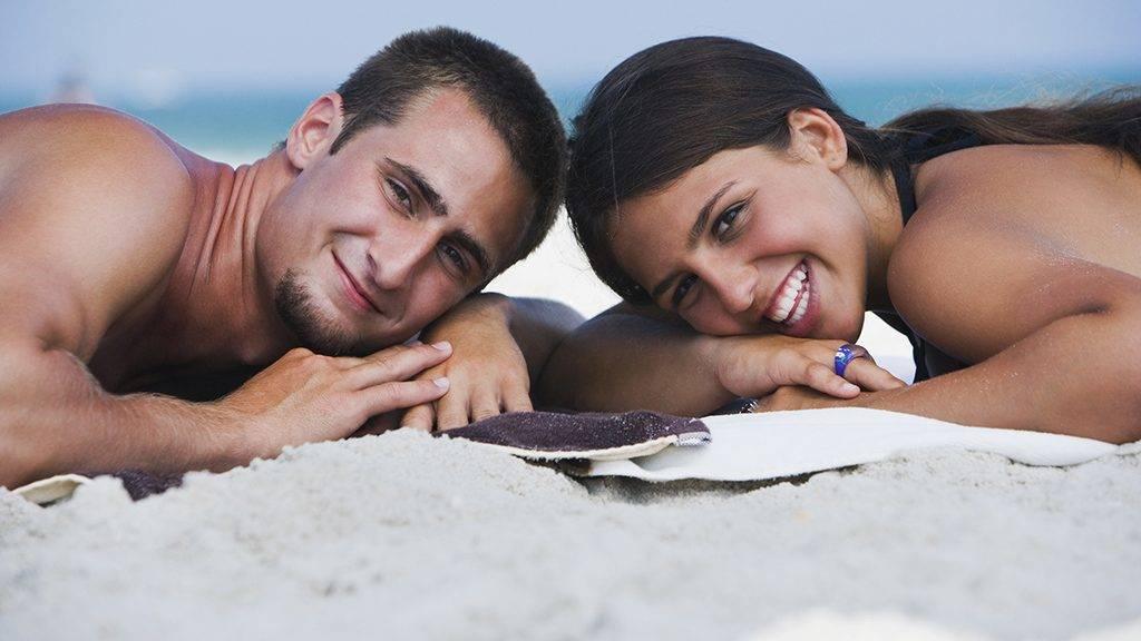 Portrait of couple lying on the beach