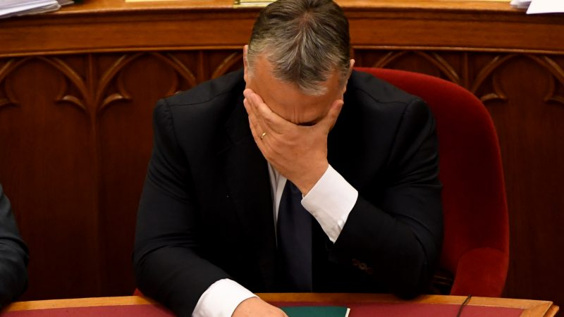 Hungarian Prime Minister Viktor Orban gestures as he attends a session at parliament on November 8, 2016 in Budapest, after a parliamentary vote on a constitutional amendment to ban the mass relocation of migrants. Hungary's radical right Jobbik dealt all-powerful Prime Minister Viktor Orban a rare defeat as it blocked his bid to change the constitution to bar the resettlement of refugees. / AFP PHOTO / ATTILA KISBENEDEK