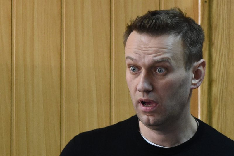 """Kremlin critic Alexei Navalny, who was arrested during March 26 anti-corruption rally, attends a hearing at a court in Moscow on March 27, 2017. Russian opposition leader Alexei Navalny was sentenced to 15 days behind bars and fined Monday after he and more than 1,000 other demonstrators were detained at an anti-corruption protest in Moscow that was branded a """"provocation"""" by the Kremlin. / AFP PHOTO / Vasily MAXIMOV"""