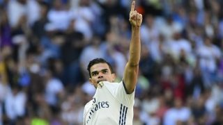 Real Madrid's Portuguese defender Pepe celebrates scoring a goal during the Spanish league football match Real Madrid CF vs Club Atletico de Madrid at the Santiago Bernabeu stadium in Madrid on April, 8, 2017. / AFP PHOTO / PIERRE-PHILIPPE MARCOU