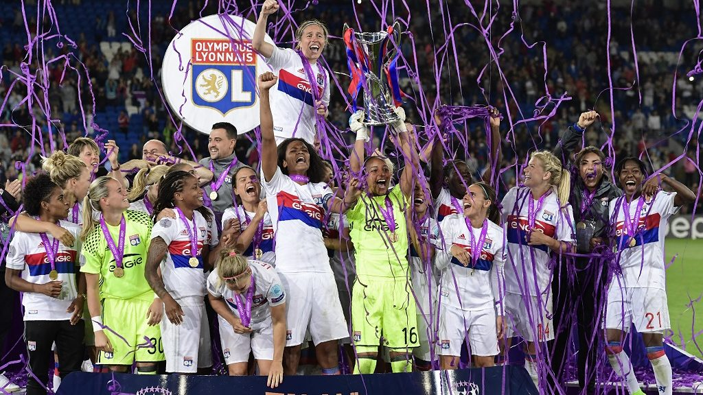 Lyon's French captain Wendie Renard (CL) gestures as Lyon's French goalkeeper Sarah Bouhaddi (CR) holds aloft the Women's Champion's League trophy as the Lyon players celebrate victory after the UEFA Women's Champions League final football match between Lyon and Paris Saint-Germain at the Cardiff City Stadium in Cardiff, south Wales, on June 1, 2017. / AFP PHOTO / JAVIER SORIANO