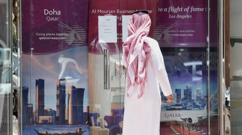 A picture taken on June 5, 2017 shows a man standing outside the Qatar Airways branch in the Saudi capital Riyadh, after it had suspended all flights to Saudi Arabia following a severing of relations between major gulf states and gas-rich Qatar. Arab nations including Saudi Arabia and Egypt cut ties with Qatar accusing it of supporting extremism, in the biggest diplomatic crisis to hit the region in years. / AFP PHOTO / FAYEZ NURELDINE