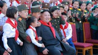 """This taken on June 6, 2017 and released from North Korea's official Korean Central News Agency (KCNA) on June 8 shows North Korean leader Kim Jong-Un (C) at a photo session with the participants in the 8th Congress of the Korean Children's Union (KCU) in Pyongyang. / AFP PHOTO / KCNA VIA KNS / STRINGER /  - South Korea OUT / REPUBLIC OF KOREA OUT   ---EDITORS NOTE--- RESTRICTED TO EDITORIAL USE - MANDATORY CREDIT """"AFP PHOTO/KCNA VIA KNS"""" - NO MARKETING NO ADVERTISING CAMPAIGNS - DISTRIBUTED AS A SERVICE TO CLIENTS THIS PICTURE WAS MADE AVAILABLE BY A THIRD PARTY. AFP CAN NOT INDEPENDENTLY VERIFY THE AUTHENTICITY, LOCATION, DATE AND CONTENT OF THIS IMAGE. THIS PHOTO IS DISTRIBUTED EXACTLY AS RECEIVED BY AFP.  /"""