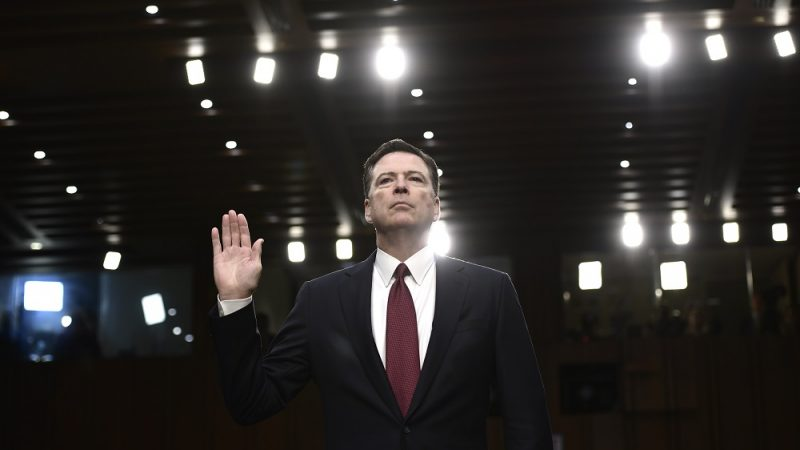 Former FBI Director James Comey takes the oath before he testifies during a US Senate Select Committee on Intelligence hearing on Capitol Hill in Washington, DC, June 8, 2017. / AFP PHOTO / Brendan Smialowski