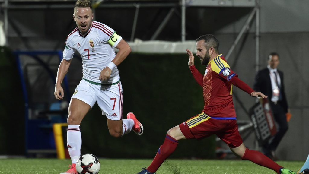 Hungary's forward Balazs Dzsudzsak (L) outruns Andorra's defender Marc Pujol during the FIFA World Cup 2018 football qualifier between Andorra and Hungary at the Municipal Stadium in Andorra la Vella on June 9, 2017.   / AFP PHOTO / PASCAL PAVANI
