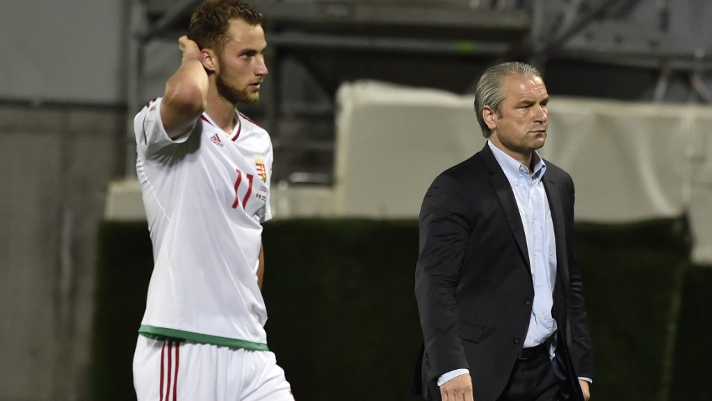 Hungary's midfielder Marton Eppel (L) and Hungary's German head coach Bernd Storck leave the pitch at the end of the FIFA World Cup 2018 football qualifier between Andorra and Hungary at the Municipal Stadium in Andorra la Vella on June 9, 2017.   / AFP PHOTO / PASCAL PAVANI