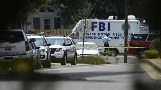 A man walks past an FBI vehicle after a shooting during a practice of the Republican congressional baseball at Eugene Simpson Statium Park June 14, 2017 in Alexandria, Virginia. At least five people people including a top Republican congressman were wounded in a Washington suburb early Wednesday morning when a shooting erupted as they practiced for an annual baseball game between lawmakers. Senior congressman Steve Scalise was shot in the hip, according to fellow Republican lawmaker Mo Brooks who told CNN at least two law enforcement officers and one congressional staffer were also shot in the incident in Alexandria, Virginia.  / AFP PHOTO / Brendan Smialowski