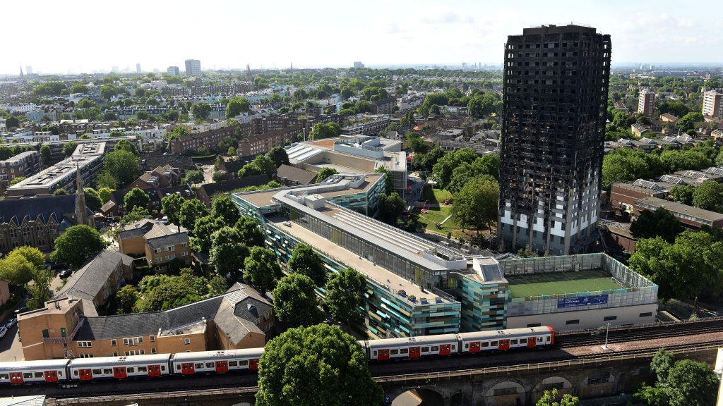 The remains of Grenfell Tower, a residential tower block in west London which was gutted by fire, are pictured against the London skyline on June 16, 2017. The toll from the London tower block fire has risen to at least 30 people dead and the flames have now been extinguished, police said on June 16, 2017. / AFP PHOTO / CHRIS J RATCLIFFE