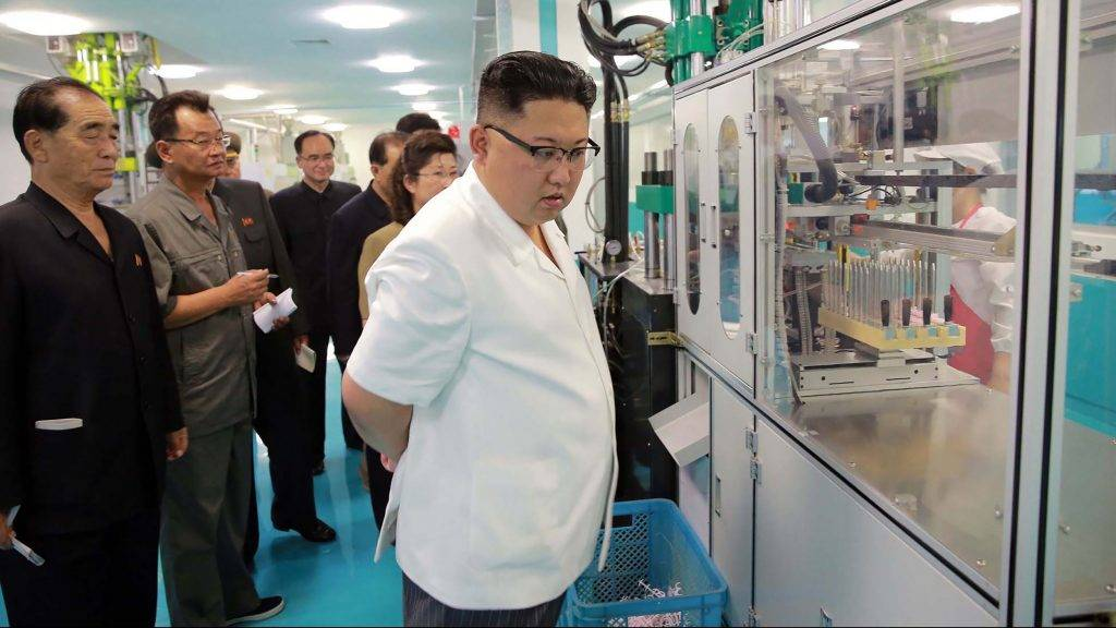 """This undated picture released from North Korea's official Korean Central News Agency (KCNA) on June 20, 2017 shows North Korean leader Kim Jong-Un (C) visiting a newly-built dental sanitary goods factory at an undisclosed location in North Korea.  / AFP PHOTO / KCNA VIA KNS / STR / South Korea OUT / REPUBLIC OF KOREA OUT   ---EDITORS NOTE--- RESTRICTED TO EDITORIAL USE - MANDATORY CREDIT """"AFP PHOTO/KCNA VIA KNS"""" - NO MARKETING NO ADVERTISING CAMPAIGNS - DISTRIBUTED AS A SERVICE TO CLIENTS THIS PICTURE WAS MADE AVAILABLE BY A THIRD PARTY. AFP CAN NOT INDEPENDENTLY VERIFY THE AUTHENTICITY, LOCATION, DATE AND CONTENT OF THIS IMAGE. THIS PHOTO IS DISTRIBUTED EXACTLY AS RECEIVED BY AFP.  /"""