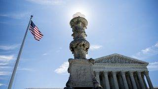 A view of the US Supreme Court during their last public session before the summer break June 26, 2017 in Washington, DC. The US Supreme Court on Monday agreed to hear the case on President Donald Trump's controversial travel ban targeting citizens from six predominantly Muslim countries. The high court also ruled that the measure can partially take effect -- a win for the Republican leader, who has insisted it is necessary for national security, despite criticism that it singles out Muslims in violation of the US constitution. / AFP PHOTO / Brendan Smialowski