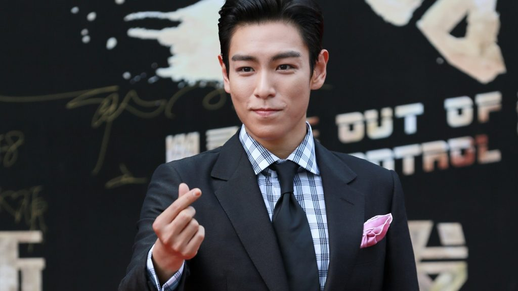 """Singer and actor Choi Seung-hyun, better known by his stage name T.O.P, of South Korean boy band Bigbang (Big Bang), arrives at a press conference for his new movie """"Out of Control"""" in Shanghai, China, 14 June 2016."""