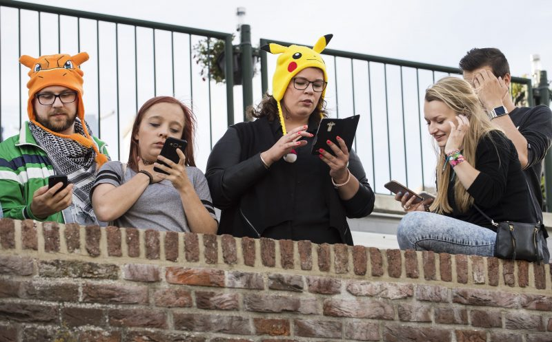2016-07-11 19:43:38 People play the new game Pokemon Go on their smartphone while gathered with others also playing the game in Leerdam, The Netherlands on 11 July 2016. The new game was released 08 July and has players playing in a virtual world that corresponds to their actual GPS location. ANP PIROSCHKA VAN DE WOUW