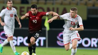 SKOPJE, MACEDONIA - JUNE 5: Arda Turan (10) of Turkey vies for the ball against Ristovski Stefan (13) of Macedonia during the Friendly match between Macedonia and Turkey at the Philip II Arena in Skopje, Macedonia on June 5, 2017.    Metin Pala / Anadolu Agency