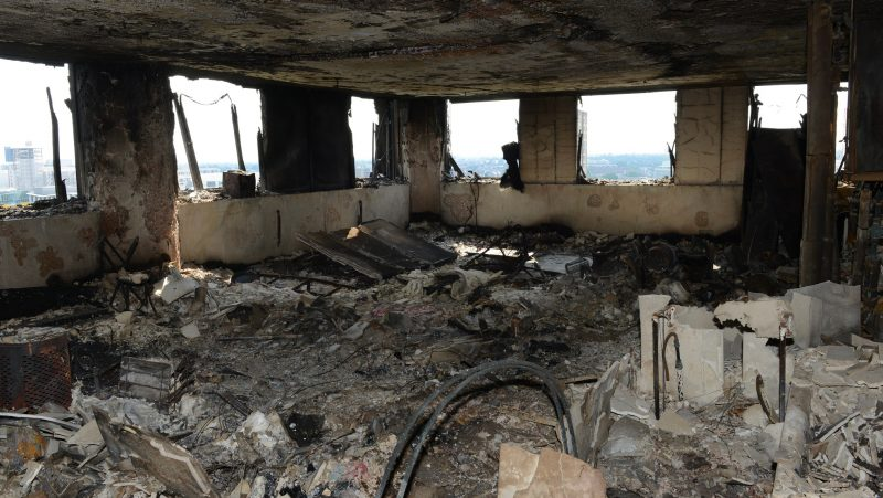 """LONDON, UNITED KINGDOM - JUNE 18: (----EDITORIAL USE ONLY – MANDATORY CREDIT - """" LONDON METROPOLITAN POLICE SERVICE"""" - NO MARKETING NO ADVERTISING CAMPAIGNS - DISTRIBUTED AS A SERVICE TO CLIENTS----) An undated handout photo made available by Britain's London Metropolitan Police Service (MPS) on 18 June 2017 shows a view on a burned flat inside the Grenfell Tower, a 24-storey apartment block in North Kensington, West London, United Kingdom. Police investigates the fire at the Grenfell Tower that broke out on 14 June 2017. At least 58 people are now missing and presumed dead in the Grenfell Tower disaster, police have said. This latest figure includes the 30 already confirmed to have died in the fire.The cause of the fire is yet not known.  London Metropolitan Police Service / Anadolu Agency"""
