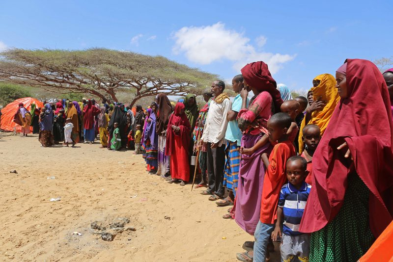 MOGADISHU, SOMALIA - MARCH 25: Somalians fight against hunger and lack of water due to drought as Turkish Ambassador to Somalia, Olgan Bekar (not seen) visits the a camp near the Mogadishu's rural side in Somalia on March 25, 2017. Sadak Mohamed / Anadolu Agency