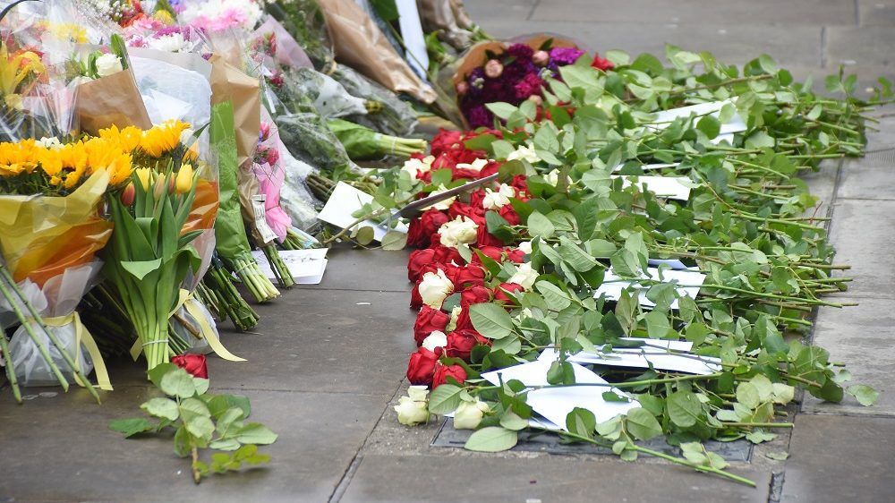 Flowers are pictured at the south-side of London Bridge in London on June 6, 2017, placed in memory of the victims of the June 3 terror attacks. Police on Monday identified two of the three London attackers as Khuram Butt and Rachid Redouane, after Britain's third terror assault in less than three months, as Prime Minister Theresa May came under mounting pressure over security just days ahead of elections. (Photo by Alberto Pezzali/NurPhoto)
