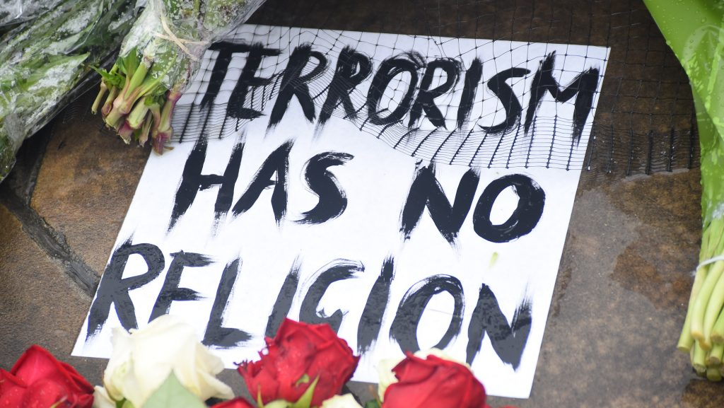 A placard have been left at London Bridge, London on June 6, 2017. A large amount of flowers, messages and placards have been left in the area, following the London Bridge and Borough Market's terror attacks in which 7 people has died and 48 were injured. (Photo by Alberto Pezzali/NurPhoto)